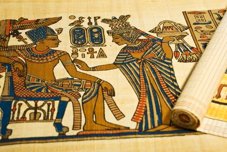 Close up of Egyptian drawings on scroll showing life from old Egypt photo