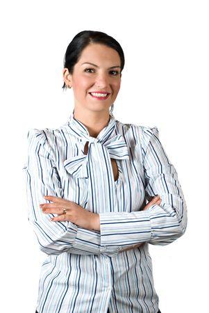 mains crois�es: Confiant entreprise jeune femme debout avec les mains crois�es et souriant isol�s sur fond blanc Banque d'images