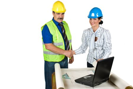 Handshake two engineers in office  for successful projects isolated on white background and copy space for text message in left part of image photo