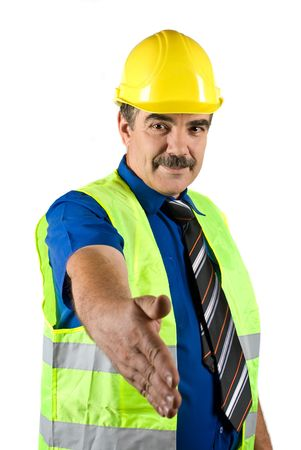 handshakes: Portrait of mature construction engineer with protective waistcoat and hard hat give handshake isolated on white background Stock Photo