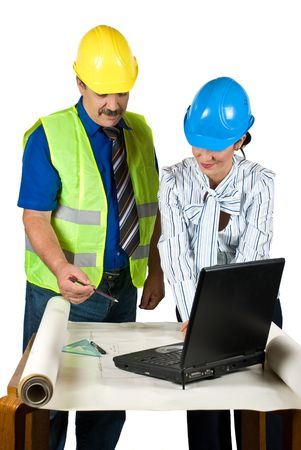 Two architects in office looking on plans , working with notebook and consulting each other about projects isolated on white background Stock Photo - 5094318