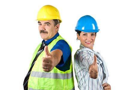 Two happy architects with hardhat standing back to back and giving thumbs -up isolated on white background photo