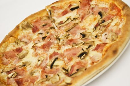 Close up of special pizza with ham and mushrooms on white background Stock Photo - 5228065