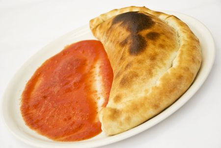 Pizza Calzone with sauce on a white plate Stock Photo - 5228053