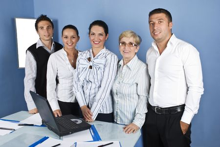 Group of five business people standing in a line and smiling  in a office Stock Photo - 5334941