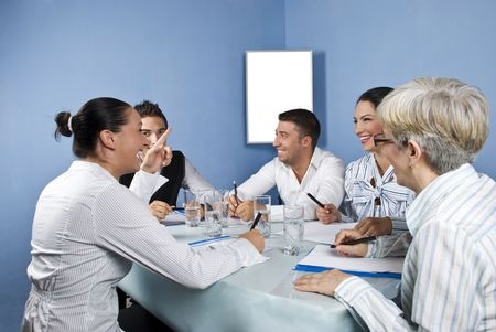casual meeting: Business group having a meeting and they discuss and laughing together,blank chart for presentation in background