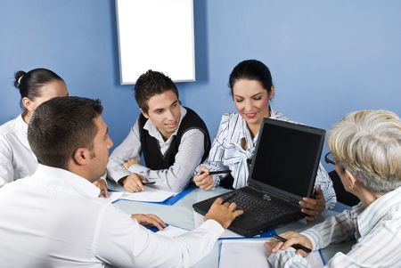 Five business people using laptop at meeting,they discuss and  a business woman showing with pencil on laptop screen photo