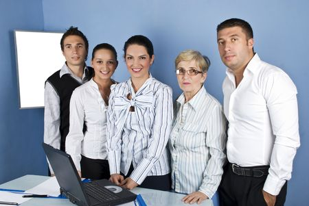 Happy group of office staff standing in a line with young and mature business people Stock Photo - 5339599
