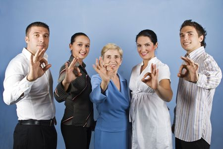 Group of united teamwork standing in a line and showing okay sign and smiling concept of successful business  photo