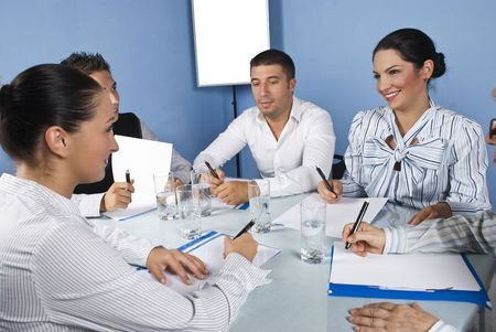 Business team of young people and friends having fun and laughing at meeting photo