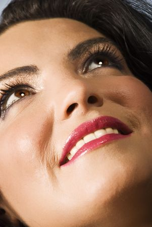 Close up of smiling woman face seen from bottom to top looking up Stock Photo - 5440516