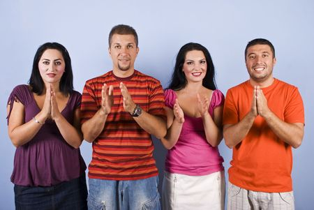 Group of happy friends standing in a row and applauding on blue background Stock Photo - 5464701