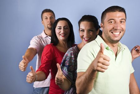 Group of happy friends walking in a line having fun ,laughing and giving thumbs up,smiling man in front of image on blue background,copy space for text message in left part photo
