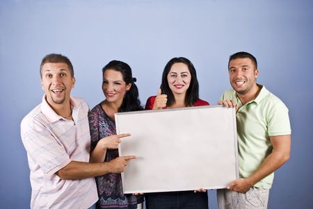 four poster: Smiles people holding a blank banner and pointing to copy space on blue background