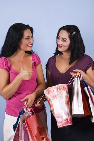 Close up of excited  two women at shopping with bags,one of them giving thumbs up to her friend happy about what she bought Stock Photo - 5477363