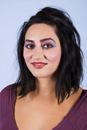Attractive brunette woman in pink violet make up eyes and red lipstick photo