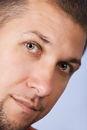 Close up of mid adult man face with blue eyes photo