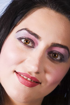 Close up of  beautiful brunette woman face with make up eyes and red lipstick photo