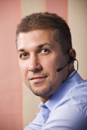 Portrait of customer service beard man with headset ,smiling and looking you photo