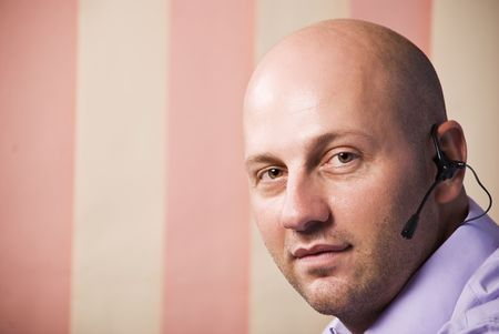 Portrait of bald man operator support smiling,copy space for text message in left part of image photo