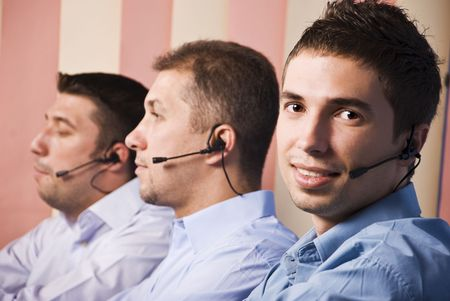 Three men support team working,focus on first man which smiling and looking you photo