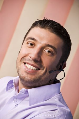 Portrait of beauty male customer service rep with headset smiling photo