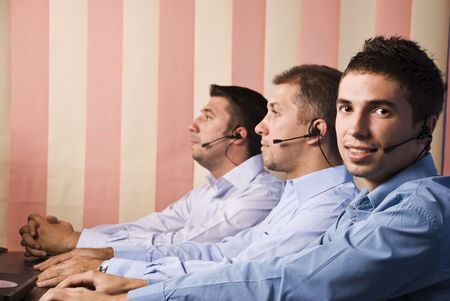 Customer service team with men in office,first man facing you and smiling photo