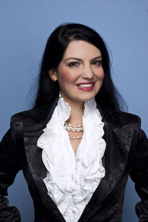 Very elegant business woman wearing a modern white shirt,pearls and a shiny satin jacket with glitter on blue background Stock Photo - 5786905