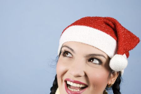Head shot of beautiful Santa woman smiling and show a surprised face and looking to copy space photo