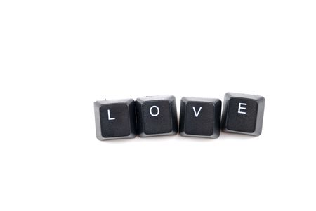 Word love composed with letters of computer keyboard isolated on white background with copy space for text message photo