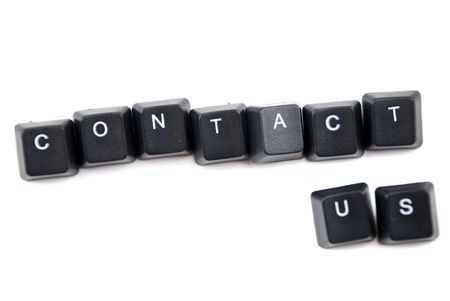 Contact us words composed with letters of computer keyboard isolated on white background and copy space for text message Stock Photo