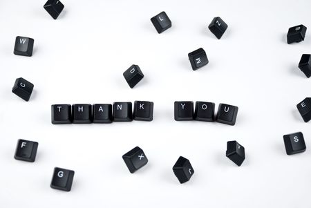 composed: Thank you words composed with black letters of computer keyboard in the middle of other letters