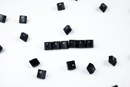 Black letters of computer keyboard around word family photo