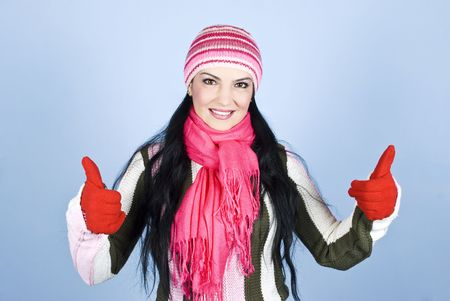Successful happy winter woman giving thumbs up with gloves in hands and smiling for you in front of blue background Stock Photo - 6005843