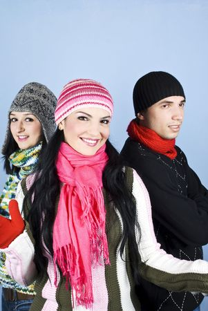 Happy group of friends wearing winter clothes they standing close each to other  with a smiling woman in front of image  photo