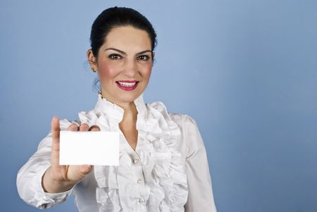 Beautiful  businesswoman in white shirt holding a blank business card and standing  in front of blue background Stock Photo - 6191988