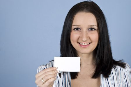 Young business woman showing a blank business card on blue background Stock Photo - 6191992