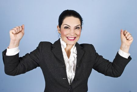 excitation: Happy woman with arms raised winning something or having a successful business