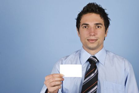 Young businessman holding a blank card and smile,copy space for text message in left part of image photo