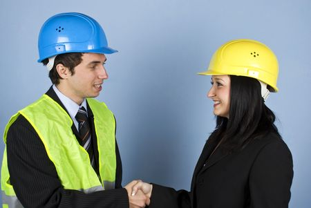 Two architects man and woman having a conversation and shaking their hands photo