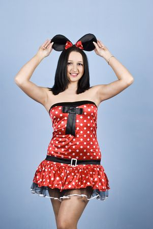 Beautiful young woman posing in a sexy mouse costume and holding ears with hands  photo