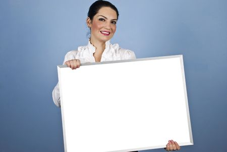 Beautiful smiling young business woman holding a white blank sign and looking you Stock Photo - 6207205