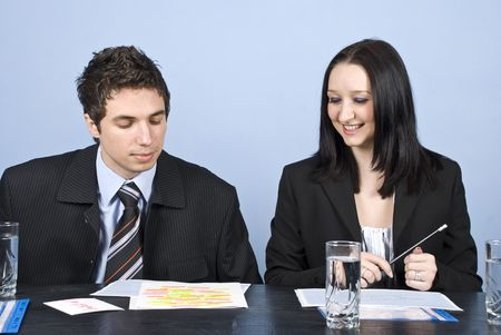 Two young business people having a meeting in office photo