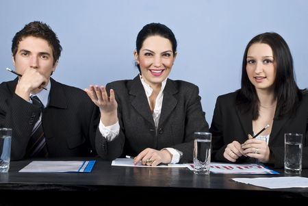 listened: Businesswoman in the middle are expressing her vision and talk about strategy at the conference and two other businesspeople listened her and looking you