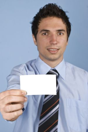 Businessman holding a visiting card,selective focus on card photo