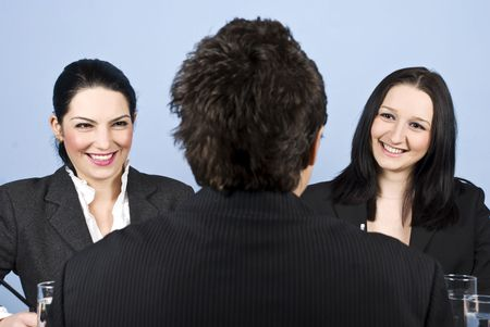 A business man back having a job interview with two business women and they laughing together  Stock Photo - 6226189