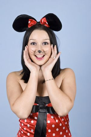 Happy girl with mouse costume and makeup holding hands to face and say:Hello! photo