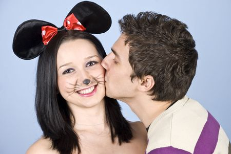 Happy mouse girl  kissed by a man and smiling for you photo