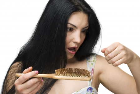 hairbrush: Shocked woman making a face because losing hair on hairbrush isolated on white background