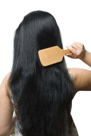 back straight: Back of young woman brushing her black very long hair  isolated on white background Stock Photo